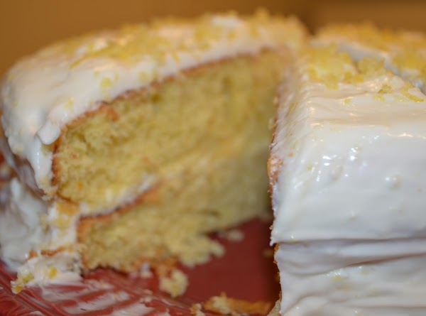 place one cake on a plate or cake stand, and spread 1/3  of...