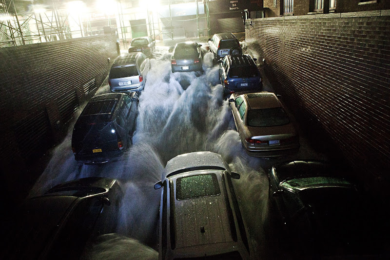 Photo: NEW YORK, NY - OCTOBER 29:  Rising water, caused by Hurricane Sandy,  rushes into a subterranian parking garage on October 29, 2012, in the Financial District of New York, United States. Hurricane Sandy, which threatens 50 million people in the eastern third of the U.S., is expected to bring days of rain, high winds and possibly heavy snow. New York Governor Andrew Cuomo announced the closure of all New York City will bus, subway and commuter rail service as of Sunday evening  (Photo by Andrew Burton/Getty Images)