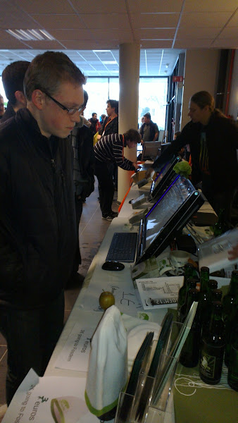 Photo: openSUSE booth at fosdem 2012Beers, t-shirts, beanies, Gnome3 & kde4 touch screen demo.openSUSE ARM on pandaboard