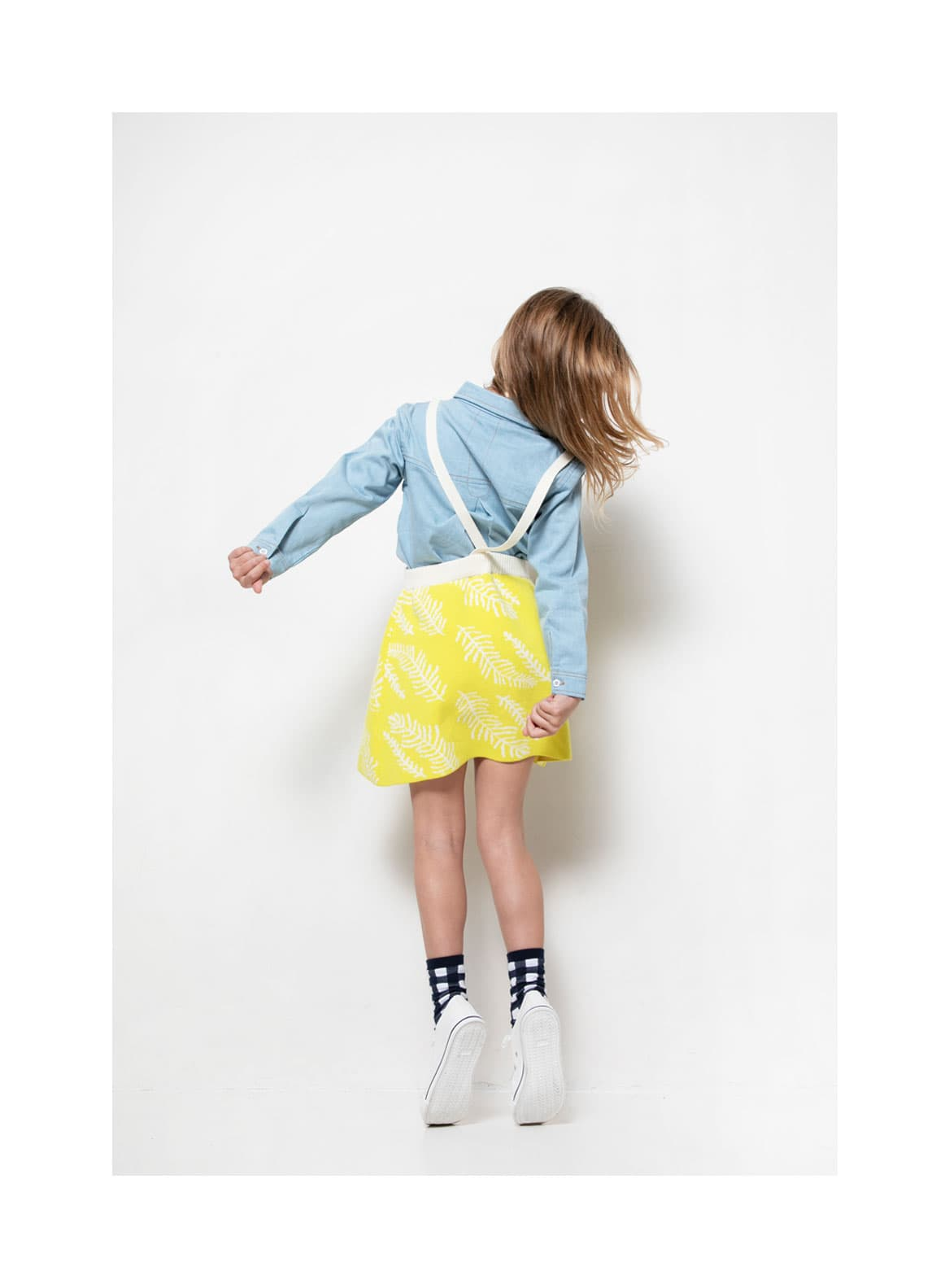 Girl with sky shirt and meadow skirt