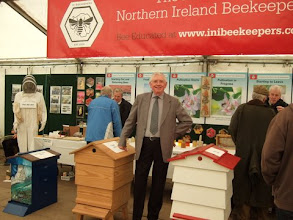 Photo: The stand organizer, Tom Canning and l-r Cecil Mc Mullan and James Crawford with the first two visitors.