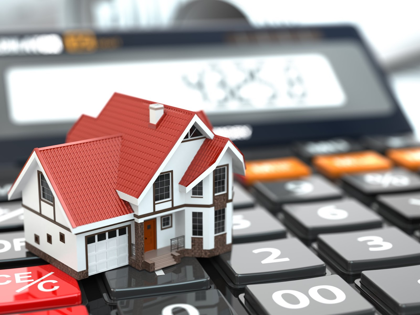 Real estate concept. House on calculator. Mortgage