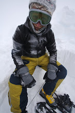 Photo: Tomek Diging a hole in the snow in a stormy day on summit plateau.