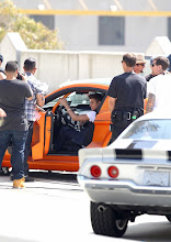 """Photo: Los Angeles, CA - Justin Bieber was in downtown Los Angeles today to shoot a music video for his new single """"Boyfriend"""".  In one scene of the video, Justin rides in a orange Ford Mustang Boss 302-X as he wears a vest over a white shirt, jeans and gold high top shoes.AKM-GSI          April 21, 2012To License These Photos, Please Contact :Steve Ginsburg(310) 505-8447(323) 4239397steve@ginsburgspalyinc.comsales@ginsburgspalyinc.comorKeith Stockwell(310) 261-8649(323) 325-8055 keith@ginsburgspalyinc.comginsburgspalyinc@gmail.comorThaissa Kantif Voigt(310) 619-0000thaissa.voigt@akmimages.net"""