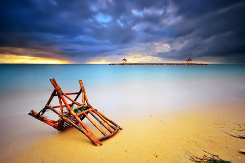 Karang Beach by Hendri Suhandi - Landscapes Travel ( clouds, karang, sand, bali, sanur, travel, beach, holiday, chair, indonesia, sunset, cloudy, sunrise )
