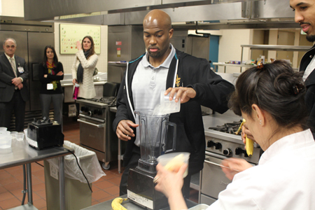 "Photo: The Cavs were joined by the Wellness Institute's Executive Chef Jim Perko and Program Manager Amy Jamieson-Petonic to quiz the students' knowledge of ways to eat healthy and teach the youngsters how they can substitute the ""bad"" food they eat for ""good"" alternatives."
