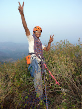 Photo: Ajit Bhobate on the summit belay. Tired, yet ecstatic. Nice bush anchor! He's a poser!