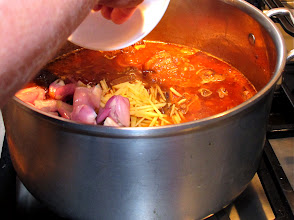 Photo: adding crushed garlic cloves, shallots and slivered ginger after simmering for 45 minutes