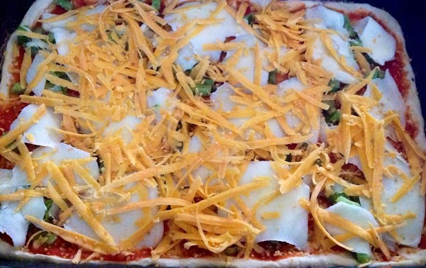 Cheesy topped Pizza Ready for the oven.