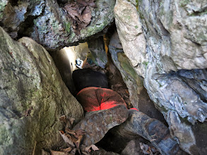 Photo: Using a laser range finder in Little Pipe Cave