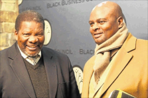 FRANK TALK: Minister  of Rural Development  and Land Reform  Gugile Nkwinti  and Lucas Mteto at the  Black Business Council               meeting                 in Sandton, Johannesburg.         PHOTO: ANTONIO MUCHAVE
