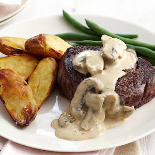 Pan-Seared Rib-Eye Steaks with Mushroom Sauce.