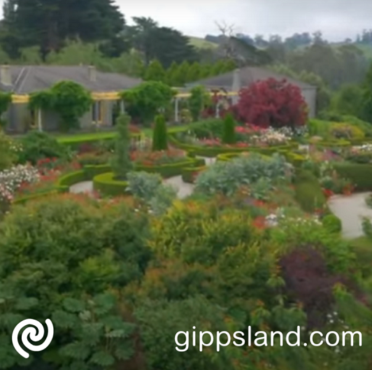 This 25 year old fairytale garden is filled with seasonal blooms, rose-lined walkways, manicured hedges and twisty paths