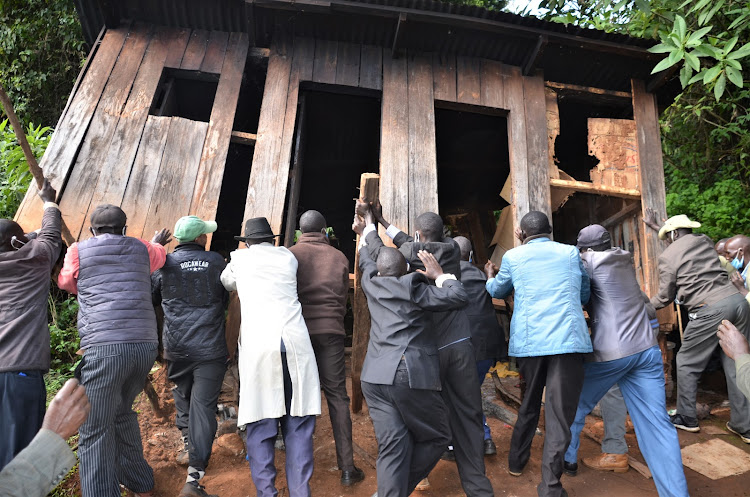 Angry residents demolish the dens of illicit brew at Katriorin location in Baringo North subcounty on August 21