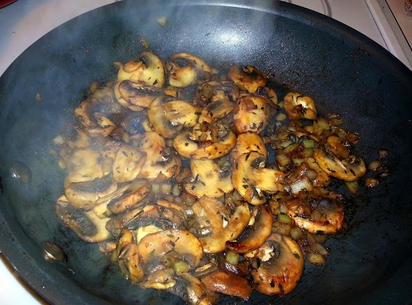 Increase heat to medium high.  Add mushrooms, onion, tyme, and salt & pepper...