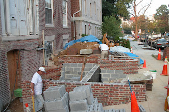 Photo: September 2005 - Month 25: New front stair going up. New brick walls are a good match with the original brick.