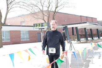 Photo: Don Grant finishes the 10K...