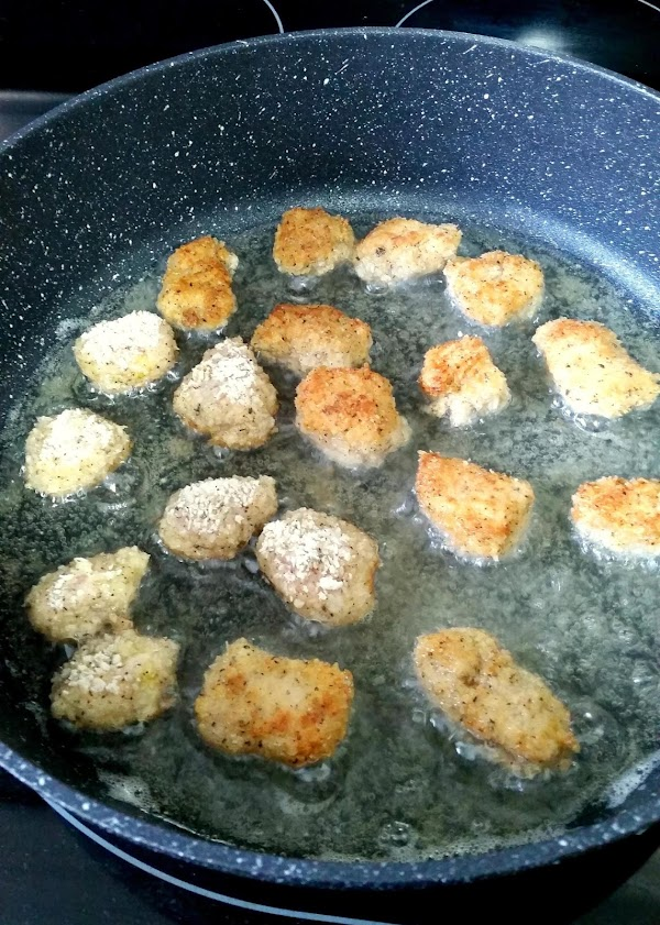 Once the oil is heated, add in the chicken (you may need to do...