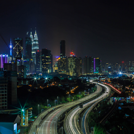 Kuala Lumpur at Night 11 by Daimasala Abdullah - Uncategorized All Uncategorized ( petronas, city, dusk, financial, scenery, malaysia, twilight, scene, view, modern, road, street, cityscape, avenue, place, highway, landmark, park, twin, architecture, kl, famous, reflection, business, metropolis, lumpur, night, center, mall, malaysian, centre, downtown, water, klcc, kuala, district, evening )