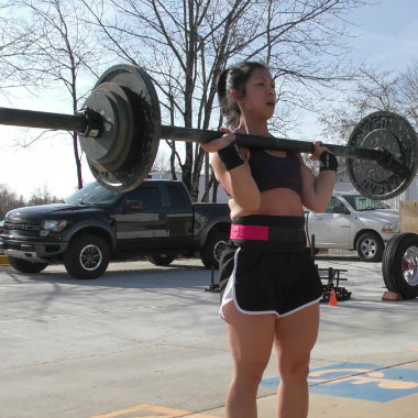 BDJ Fitness client Mary Cotta cleaning an axle bar