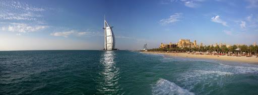 Beachfront hotels run up to the distinctive Burj Al Arab hotel in Dubai.