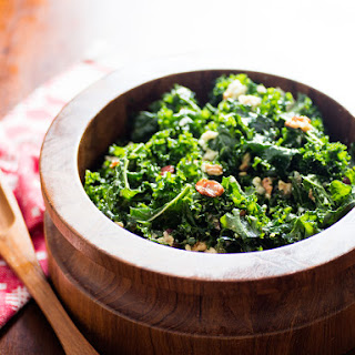 Kale Salad With Oven-Dried Grapes, Toasted Walnuts, and Blue Cheese