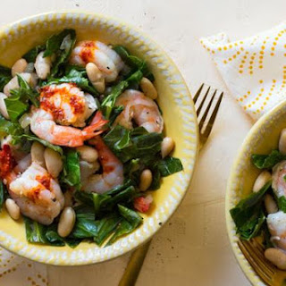Garlic Shrimp With White Beans And Collard Greens.