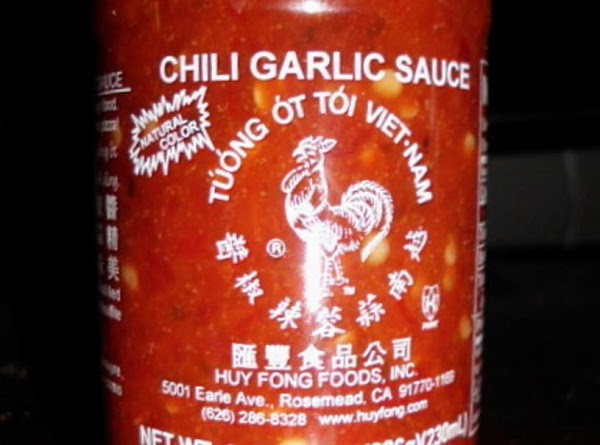 Remove from oven and top with chopped cilantro and Thai chile sauce.