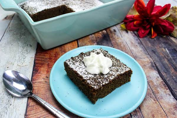 Old Fashioned Molasses Cake With A Dollop Of Whipped Topping.