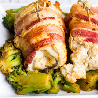 Smoked Bacon Wrapped Swiss Stuffed Chicken Breasts.