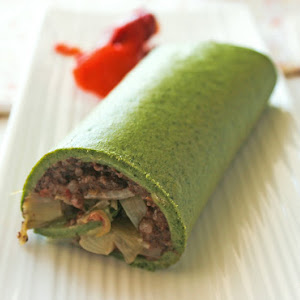 Spinach Roll with Black Sausage and Pepper Sauce