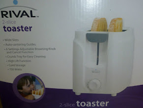 Photo: Aunt Whitney doesn't have a toaster in her new house in San Francisco, so we made a stop for my favorite one. Only $7.98!! Walmart's prices are the best!