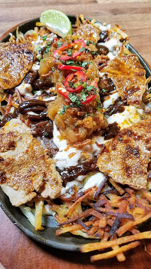 Expatriate Brunch, all hash brown platters will pale in flavor after you enjoy the Smothered and Covered Expatriate Hash Browns with pho sour cream, sharp cheddar, thai chili & sauteed onion, salsa, basil, thinly sliced eye of round, hoisin-tamarind sauce, and fried shallots.