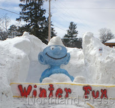 Photo: This winter smurf was created by Andy Badgerow and Crew. The  sculpture took second place in the competition last Saturday - photo  by Brenda Brodmarkle
