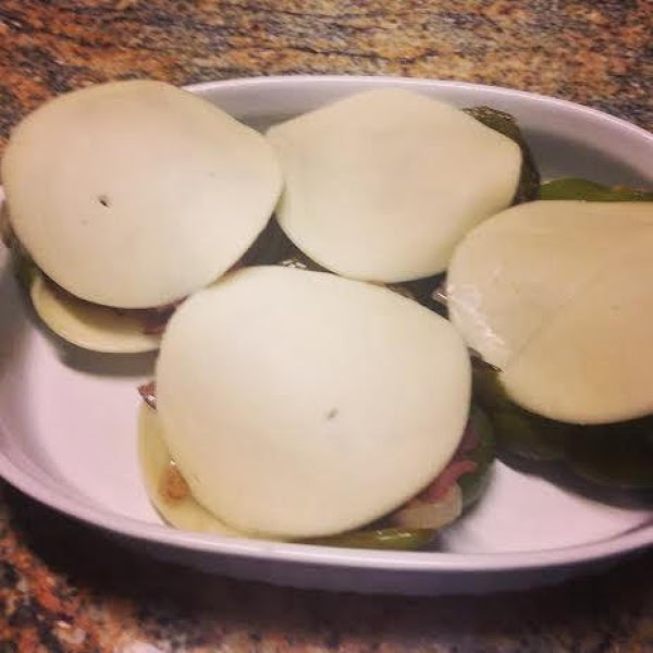 Line the inside of each pepper with a slice of provolone cheese.When the meat...