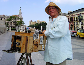 Photo: man using vintage camera, havana. Tracey Eaton photo
