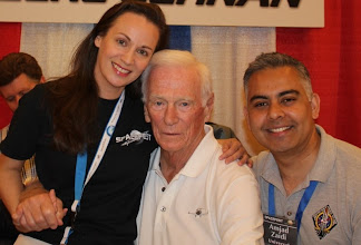 Photo: Holding hands with the last man on the Moon: Apollo 17 Commander Gene Cernan! And yes, I'm really sitting on his lap. He winked and patted his leg as an invite when we asked for a photo --what's a lady to do?!