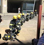 Firefighters honour their colleagues who died when a Gauteng government building caught fire in Johannesburg CBD.
