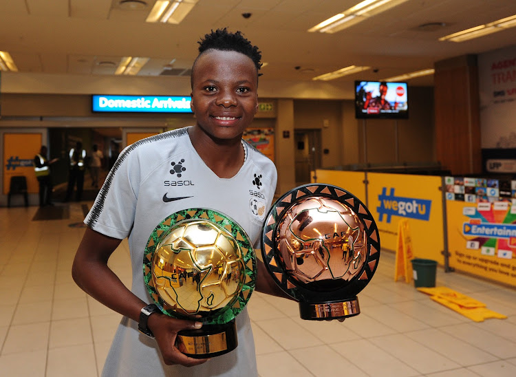 Banyana Banyana striker Thembi Kgatlana poses with her awards at the OR Tambo Airport on her return from Dakar in Senegal where she won the CAF African Women's Player of the Year as well as the African Goal of the Year on January 10 2019.