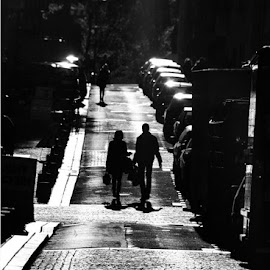 Couple walking in the sunset by Yann Marchelan - City,  Street & Park  Street Scenes ( black and white, sunset, street, couple, street photography )
