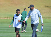 Bafana Bafana head coach Molefi Ntseki (R) has a personal ambition to win the World Cup.