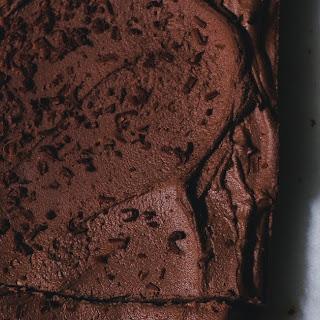 Walnut Sheet Cake With Chocolate Frosting.