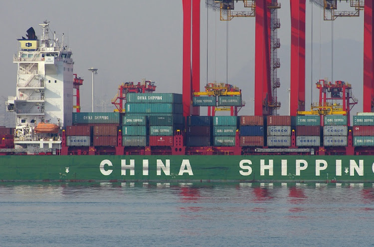 SLOWDOWN: A ship docked at a port in Rizhao, Shandong province, China. Both imports and exports have continued to fall this month, amid a tepid domestic and global economy. Picture: REUTERS