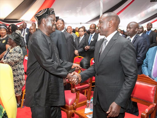 Deputy President William Ruto greets ODM leader Raila Odinga when the two met at Joseph Kamaru's funeral service in Murang'a on Thursday, October 11, 2018. /COURTESY