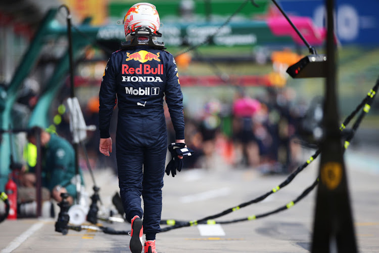 Max Verstappen of Netherlands and Red Bull Racing walks in the Pitlane after stopping on track during practice ahead of the F1 Grand Prix of Emilia Romagna at Autodromo Enzo e Dino Ferrari on April 16, 2021 in Imola, Italy.