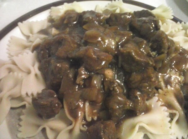 Serve the beef mix over the noodles