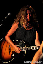 Photo: Stacy strums a tune