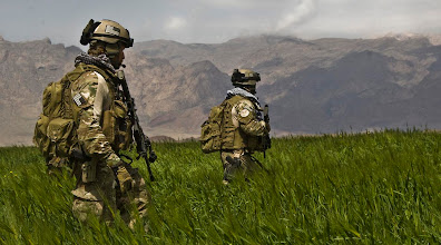 Photo: Afghan National Army (ANA) Commandos with the 207th Kandak are on a routine patrol on April 12 2009 in Gulistan district Farah province.(CJSOTF-A photo by Spc. Joseph A. Wilson.)