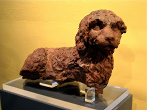"""Photo: Sculpture dog is all, """"Can I have my legs back now?"""""""
