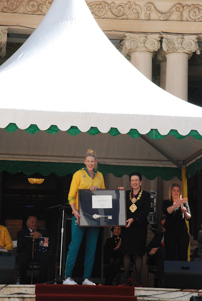 Photo: Lord Mayor Clover Moore MP presents Lauren Jackson with the key to the city.